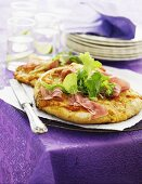 Mini pizza with Parma ham and fresh herbs