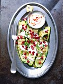 Grilled courgettes with a spicy yoghurt sauce and pomegranate seeds