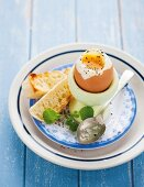 A soft-boiled egg with grilled bread