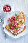 Quark pancakes with rhubarb compote and lemon balm