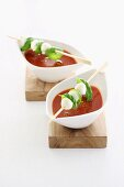 Tomato soup with mozzarella and basil skewers