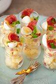 Potato salad with salami and quail's eggs