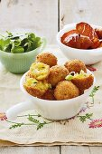 Curried fish balls, glazed potatoes and spinach