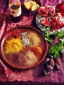 Moroccan spices - Saffron, ground cummin, ground coriander, ground sumac, pomegranate, preserved lemon, dates, Fresh mint leaves