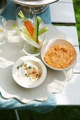 A duo of dips (nut dip, pepper paste) with vegetable crudites