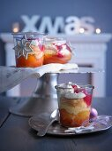 Vanilla peaches in jars with an almond sponge topping, raspberry sauce and whipped cream (Christmas)