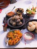 Aioli and mojo with salted potatoes, vegetable sticks, empanadas and saffron prawns