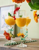 Passion fruit daiquiri garnished with flowers