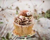A hedgehog cupcake with chocolate and coffee cream