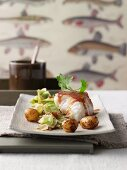 Barbecued loach fillet on fried pointed cabbage with raisins