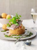 Sturgeon fillet steamed in apple wine on honey turnips with Frankfurt pesto and small, breaded potatoes