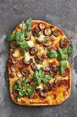A pizza with aubergines soaked in Chardonnay