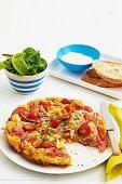 Fluffy ham and tomato omelette