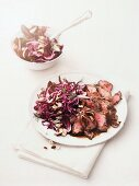 Marinated beef with a red cabbage salad, cashew nuts and dill
