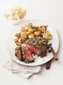 Beef rib with a herb crust and fried potatoes
