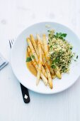 Asparagus with orange sauce and couscous