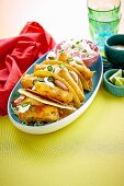 Fish tacos with jalapeno and radish slaw