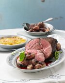 Sauerbraten (marinated pot roast) from milk-fed lamb with caramelised onions and potato gratin