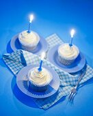 White chocolate cupcakes with blue candles