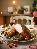 Sliced roast turkey with shallots and sage for Christmas