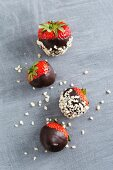 Chocolate-coated strawberries and chopped almonds
