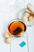A cup of peppermint tea with white chocolate truffles and sponge fingers