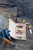 Various fishing utensils on a rocky beach