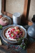 A buckwheat crepe with goat's cheese and beetroot