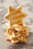 A stack of star shaped biscuits with one standing on edge