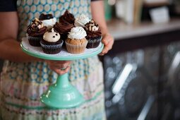 Vegan cupcakes on a turquoise coloured cake stand