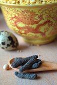 Pippali (long pepper) and a quail's egg
