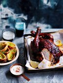 Memphis-style beer can chicken with potato skins