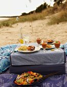 A beach picnic with a pasta salad, cold tomato soup and canapés