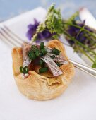Potato and cheese pie with chives and herring