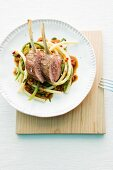 Lamb chops on macaroni with vegetables sauce