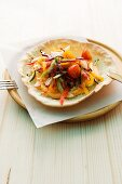 Raw vegetable salad in a bread dish