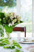 Spring flowers on set table
