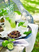 Olives and jug of lime drink