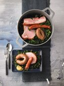 Kale with sausage, bacon and smoked pork chops