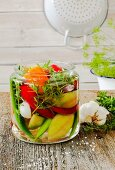 Pickled peppers with garlic and herbs