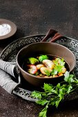 Stuffed dumpling soup with Brussels sprouts and baked apples
