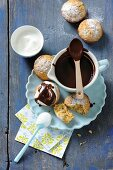Pumpkin muffins with cream and chocolate sauce