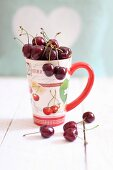 Fresh cherries in a cup