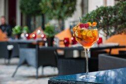 A citrus fruit cocktail on a patio table (Buddha-Bar Hotel, Paris)