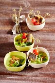 Lamb's lettuce soup with branzini skewers