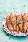 Raw, marinated chicken skewers