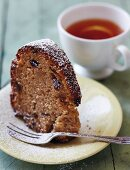 A slice of Bundt cake served with tea