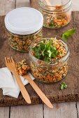 Mixed quinoa in a jar with coriander