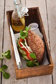 A vegan wholemeal sandwich with cucumber and tomatoes