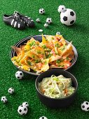 Gratinated nachos with guacamole for a football themed party